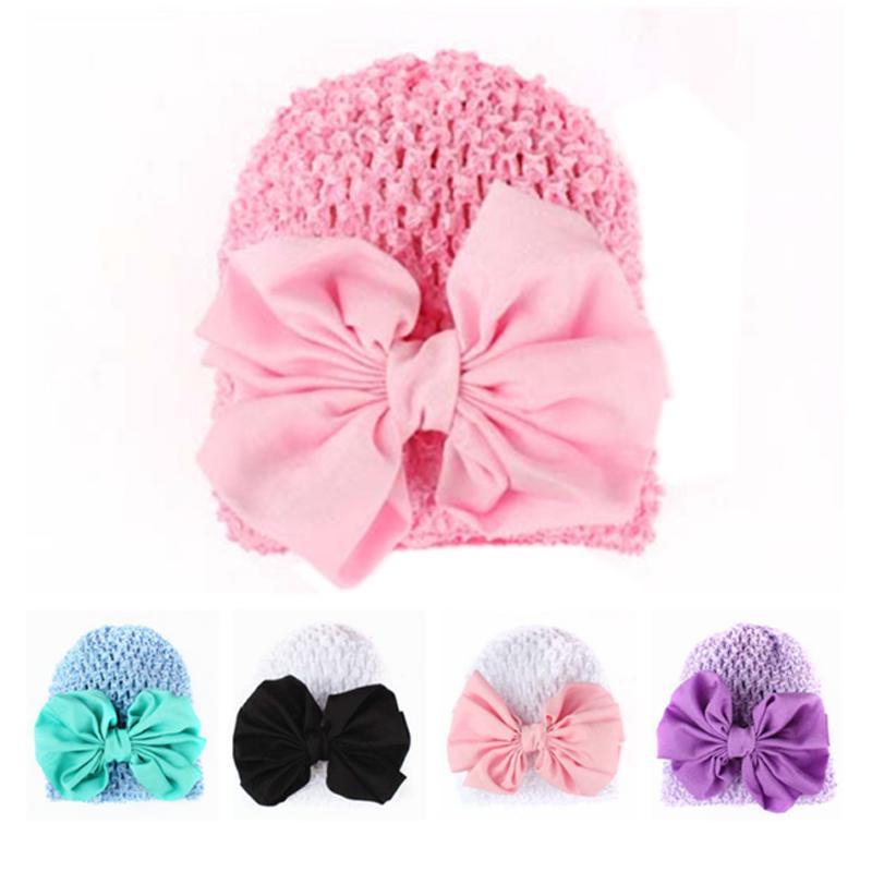 Малышей младенческой ребенка бантом выдалбливают Hat девочка головные уборы шапки фото
