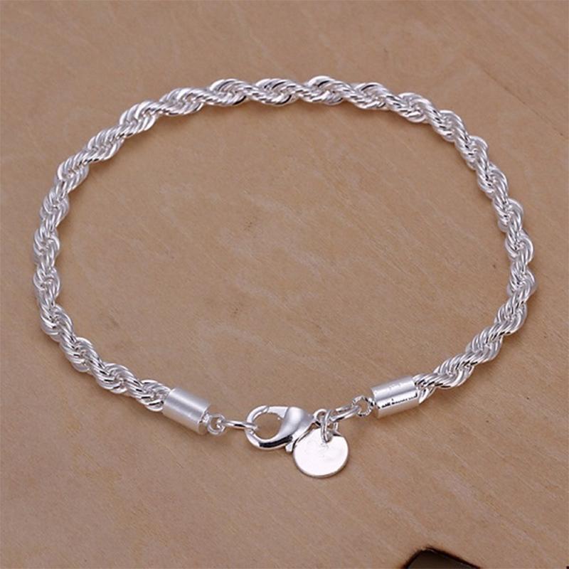 Чудесный женский браслет из сплава под серебро в виде крученой цепи 20 см фото