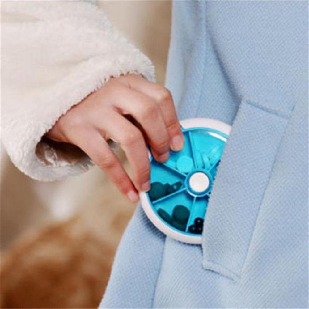 创意批发七格圆形药盒一周七格多功能塑料小药盒旋转便携七格星期9*9*3