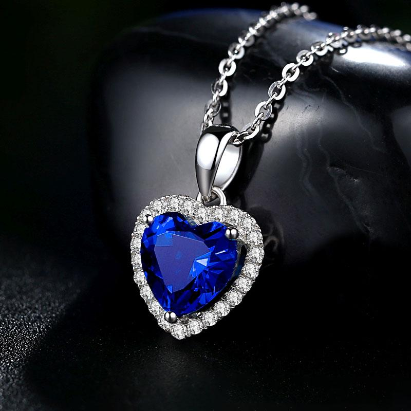 Heart pendant with blue crystal snowflake in silver and blue