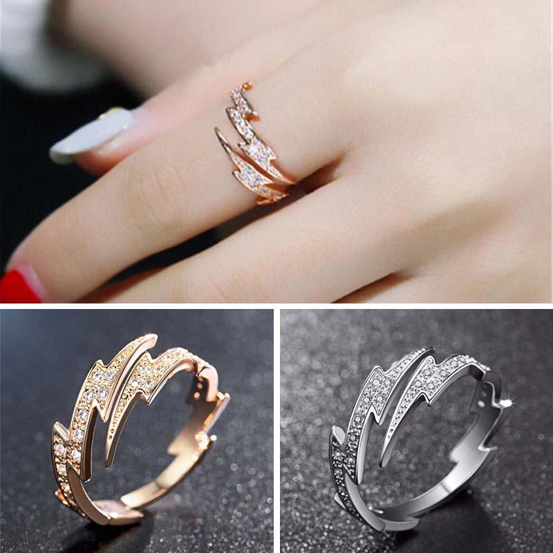 Регулируемое женское кольцо из сплава в виде молнии с прозрачными стразами фото