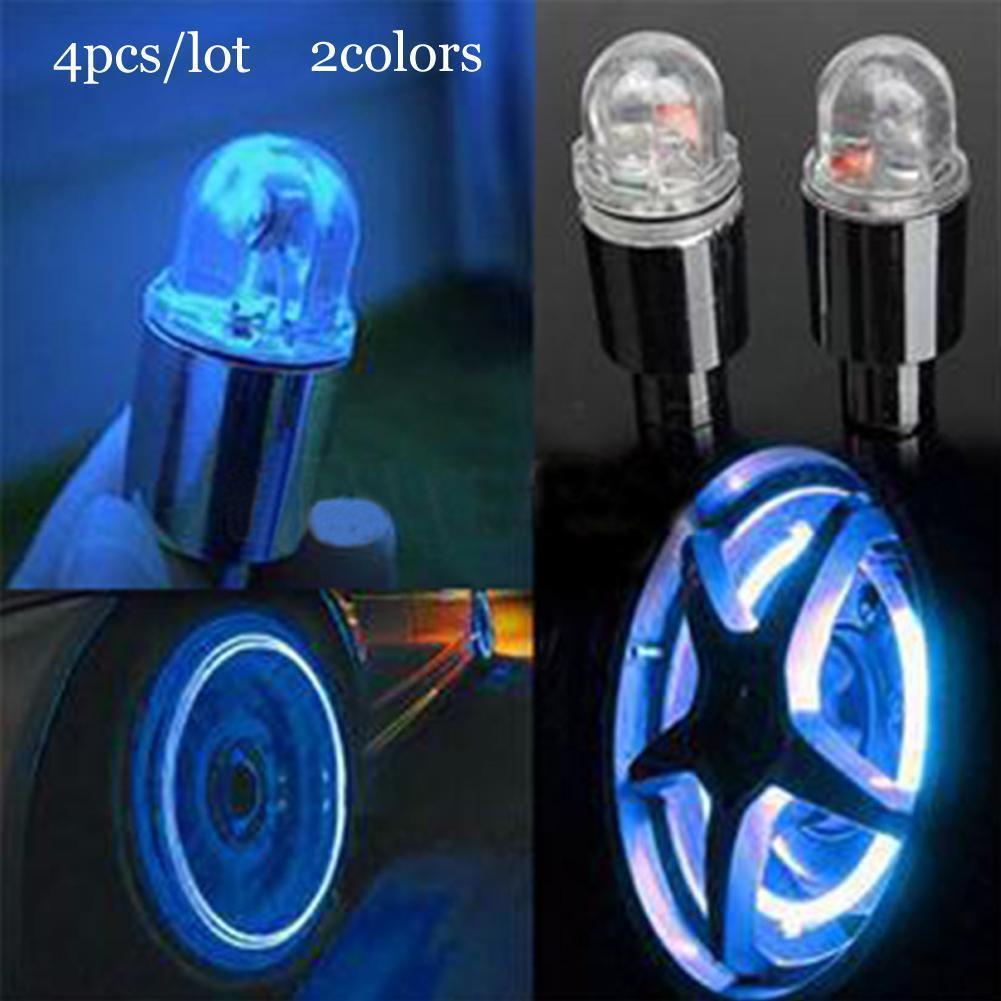 2pcs Bicycle Wheel Tire Valve Stem Cap Neon LED skull Lights Lamp Four Color
