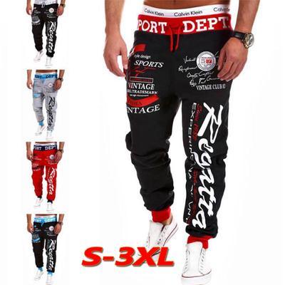 Fresco moda holgada carta de los hombres de pantalón largo impresión  holgados harén pantalones jogging y 25db47f1c02d