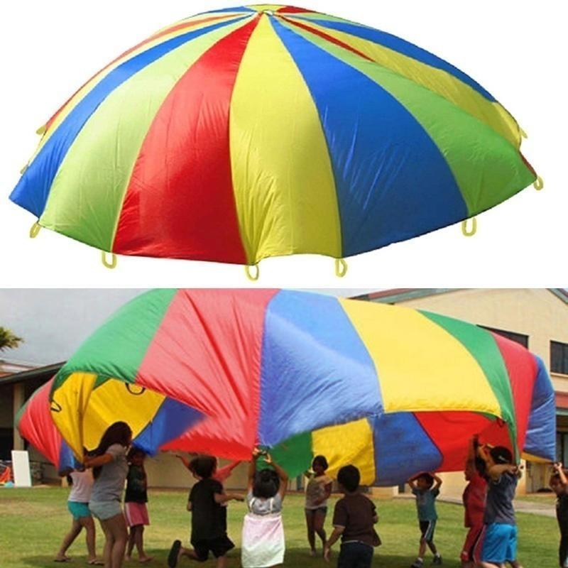 e1628da92e8c Niño niño deportes desarrollo al aire libre de arco iris paraguas ...