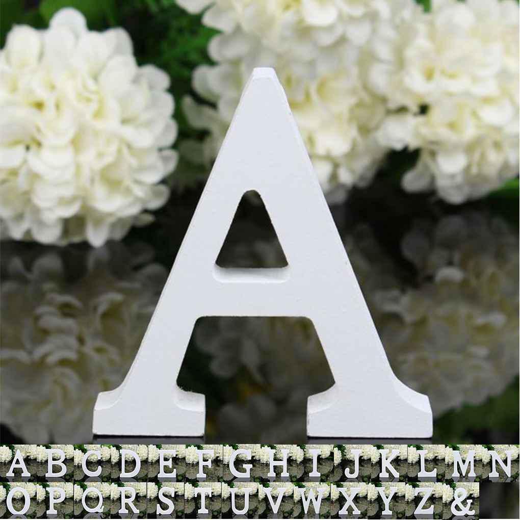 26 заглавных белых деревянных букв латинского алфавита для декорации вашего дома. Высота 8 см. Ширина 6-7 см. Буквы легко могут быть окрашены в любой нужный вам цвет фото
