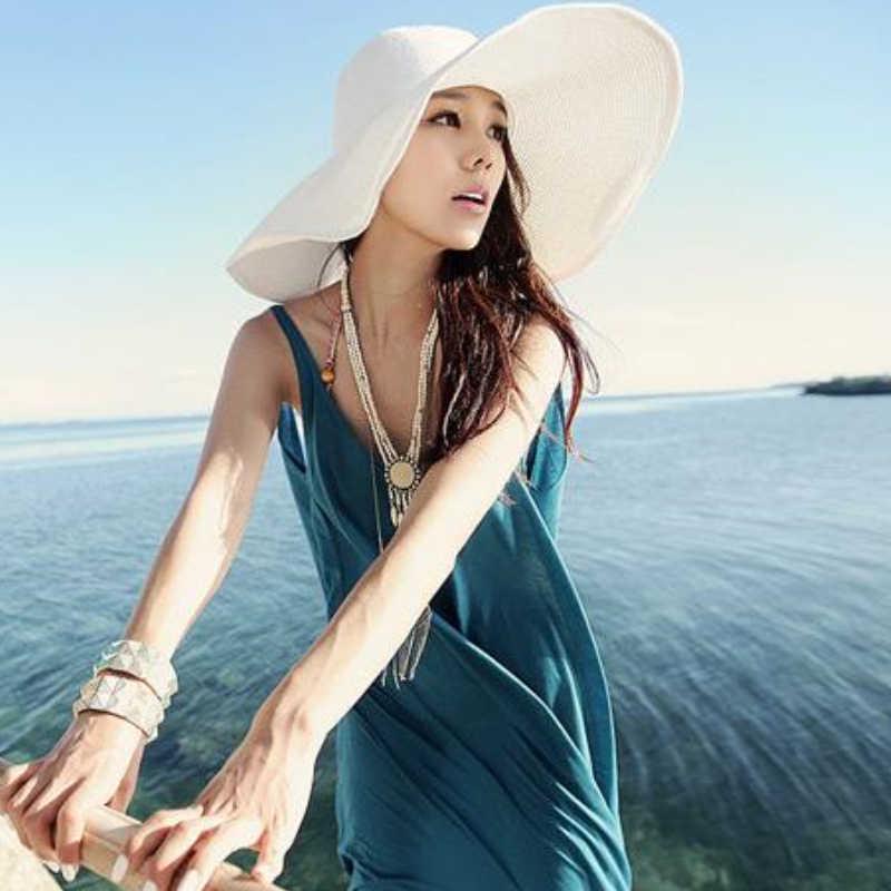 Moda verano mujeres playa plegable de ajuste de ancho sombrero paja ... 88aa653b98b