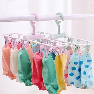 ... Clothing Space Saver Wonder Magic Hook Closet Organizer. Buy · Folding Plastic Hangers Multi - Function Windbreaker Racks Underwear Socks Drying Rack
