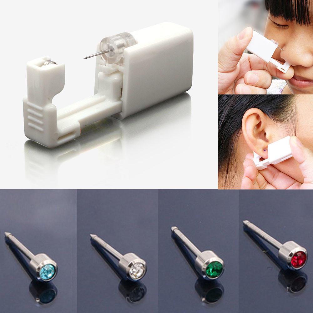 Одноразовый стерильный набор инструментов для пирсинга уха носа или губы : пистолет с встроенными серьгами фото