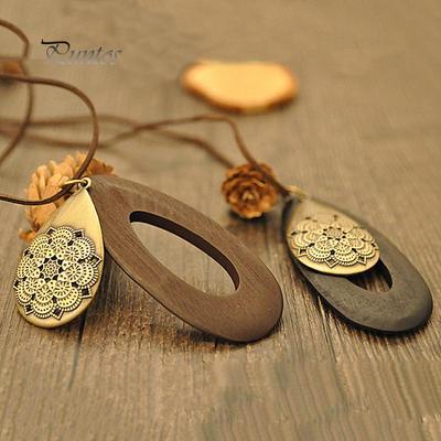 a659585c7dce Las mujeres Vintage talla madera Waterdrop terciopelo cuerda collar joyería